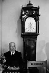 Bob Willoughby, Alfred Hitchcock next to the Grandfather clock on on the Universal Studios set of Marnie, 1964