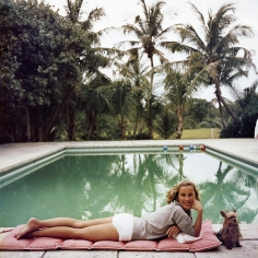 Slim Aarons, Having a Topping Time, 1959: Socialite Alice Topping relaxing poolside in Palm Beach