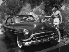 Avery, Rock Hudson Washing his Oldsmobile Outside his Hollywood Hills Home, 1952