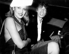 Ron Galella, Mick Jagger and Jerry Hall at a party for Reid Rogers, Limelight, New York, 1984