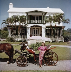 Slim Aarons, Bermudan Hostess: Polly Trott Hornburg in front of her father's house, 1957