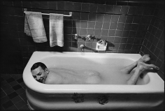 Mary Ellen Mark, Donald Sutherland relaxes in a bathtub between takes  on the set of The Day of the Locust,  Los Angeles, California, 1974