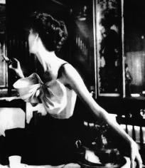 Lillian Bassman, Across the Restaurant: Barbara Mullen in a dress by Jacques Fath at Le Grand Vefour, Paris. Harper's Bazaar, 1949