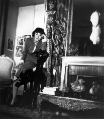 Louise Dahl-Wolfe, Coco Chanel Leaning on Chair in her Apartment, Paris, 1954