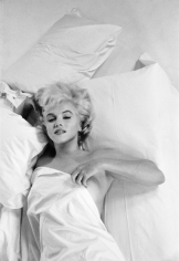 "Eve Arnold, Marilyn Monroe resting between takes during a photographic studio session in Hollywood, for the making of the film ""The Misfits"", 1960"