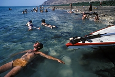 Harry Benson, Israeli Soldier relaxing in the Dead Sea, 1983
