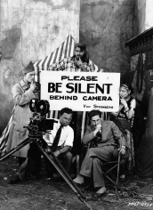 """Unknown Photographer, Josef von Sternberg, Maximilian Fabian, Conrad Nagel (left), Matthew Betz (behind sign), and Renee Adoree during the shooting of MGM's silent film """"Exquisite Sinner"""", 1926"""