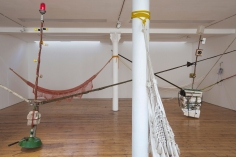 Spacemen/Cavemen 2011-2017 mixed media (two wooden poles, light bulbs, CD player, speakers, polystyrene, plastic bottle, ropes, ratchet straps, hammocks)
