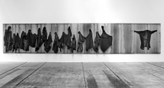 Untitled 2012 iron panel, iron hooks and overcoats