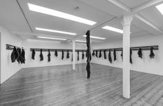 Untitled 2014 iron beams, knives and torn coats