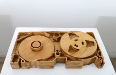 A video cassette, scaled up and hand carved out of wood.