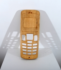 An old-school mobile cover, scaled up and hand carved out of wood.