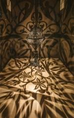 Anila Quayyum Agha The Greys in Between  2018 Powder coated laser-cut steel and lightbulbs  18 x 5 x 5 ft.