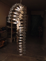 Adeela Suleman, Remains, 2008, Steel drain covers, steel tongs, nuts and bolts, 44 x 16 in
