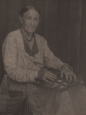 09. Doris Ulmann, Untitled (Basket weaver), ​1928–1934. Seated woman weaving a basket in her lap.