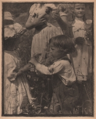 03. Gertrude Käsebier, Happy Days, 1903. Five children playing outdoors amid tall grass and flowers. One child holds a cat.