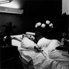 Woman in hospital bed by Peter Hujar