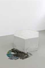 Isa Melsheimer. Selbstentzündet, 2011.Reinforced concrete, t-shirt, boiled linseed oil, pearls, sewing thread, 40 X 76 x 105 cm. Courtesy of the artist andEsther Schipper.
