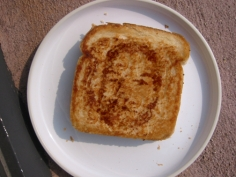 Joe Ovelman Joe as Victim on Grilled Cheese c-print, 18 x 20 inches