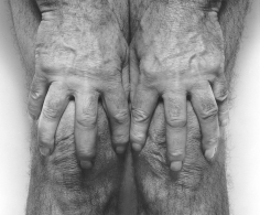 Hands Spread on Knees, 1985, 	Gelatin silver print mounted to board, printed c. 1990s
