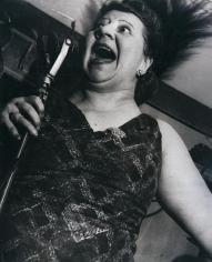 Lisette Model - Singer at Café Metropole, c. 1946 Gelatin silver print, 19 3/8 x 15 1/2 inches ; Bruce Silverstein Gallery