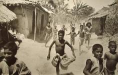 Werner Bischof - Bihar, India (Famine in India, Food arrives at a village), 1951 Gelatin silver exhibition print mounted to masonite | Bruce Silverstein Gallery