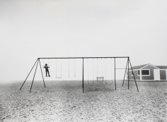 Larry Silver - Boy Standing on Swing, Compo Beach, Westport, CT, 1975 | Bruce Silverstein Gallery