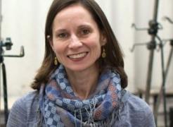 """Head shot portrait of Carolyn Case in The Woven Tale Press Magazine, """"Carolyn Case: WTP Spotlight"""""""