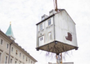 This House Dangling From A Construction Crane Is Art, Not An Accident