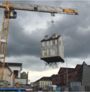 Why Is This House Dangling From the Art Of a Crane