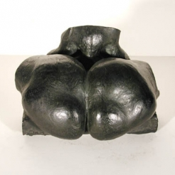 Black colored sculpture of a two oval shapes forming a heart next to each other resembling a human buttocks.