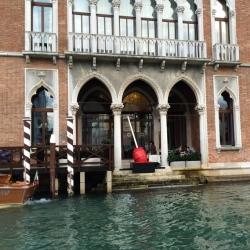 Artist Installs Nine-Foot-Tall Cherry Meltdown Along Venice's Grand Canal
