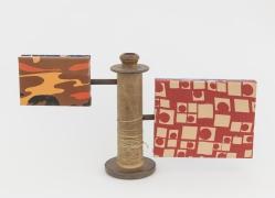 Sentinel, 2018, wooden blocks, fabric, found spool, plumbing parts