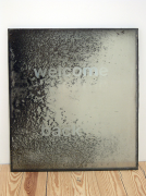 Welcome, 2009, city dust and pollution on insulated window