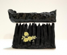 French Bread Pizza Coffin on a Fence, 2005, glazed ceramic with collage