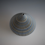 Ogata Kamio (b. 1949), Top-likeneriage(marbleized) vessel with carved, ridged surface
