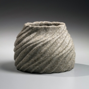 Flattened vase with raised mouth decorated with diagonally carved rippling patterning, ca. 1995