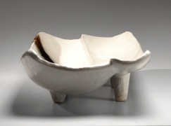 Nishihata Tadashi (b. 1948), Vessel with two oblong concave sections, four short feet all covered with a thick Tamba-style ash glaze