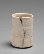 Okabe Mineo (1919-1990), A pair of straight-sided Mino ware teacups: one Oribe type and oneShino type with patterning in iron-oxide