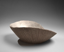 Hoshino Kayoko (b. 1949), Leaning gray vessel with straw rope impressed patterning and silver interior, titled Cut-out 19-8