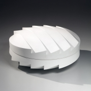 Wada Akira (b. 1978), Carved circular covered box with zig-zag faceted base and cover