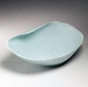 Rounded rectangular shallow footed bowl with furling rim and two carp in relief in interior, ca. 1995