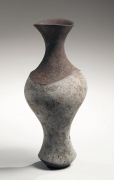 Elongated vase with flared mouth and enlarged center