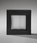 Itabashi Hiromi, Wall hanging sculpture comprised a white unglazed porcelain, creased elements encased in black, metallic glazed thick framework, titled Association with White