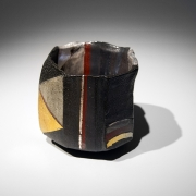 Ajiki Hiro (b. 1948), Black basara faceted and flattened teabowl with vertical bands and gold interspersed with repeated triangular patterns in colored salt glazing