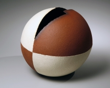 Spherical sculptural vessel with adjacent quadrants in crackled matte white glaze, 2007