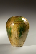 Yellow, brown and green-glazed tsubo with shishi lion design in relief within medallions, 1920's