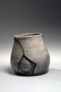 Leaning vessel with geometric patterning, ca. 1970