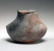 Kohyama Yasuhisa (b. 1936), Slightly flattened, bag-shaped Shigaraki vase with irregular mouth and incised circular patterning