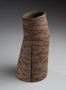 Columnar, slightly bent vessel, 1984
